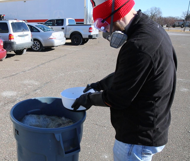 Wearing protective gear during a bleach cure of live rock