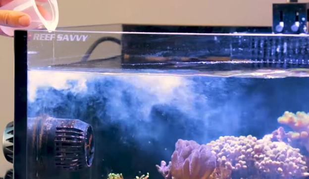 Dosing additives into aquarium